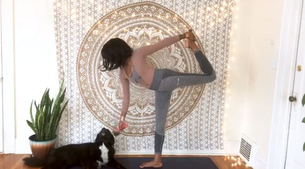 Groomer & Yogi Deja Pearson does standing bow pulling pose with her dog