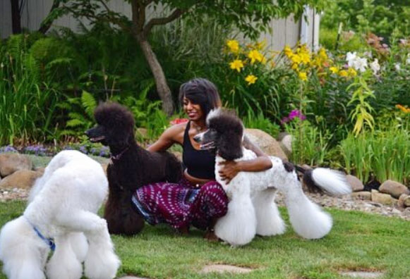 Deja Pearson and 3 poodles
