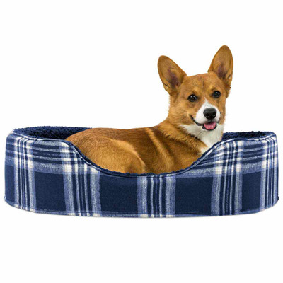 Dog laying in Blue Medium FurHaven Plaid Oval Terry Fleece Bed