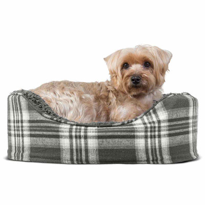 Dog snuggled up in the Gray Small FurHaven Plaid Oval Terry Fleece Dog Bed