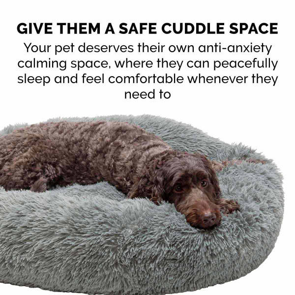 The safe cuddle space of the FurHaven Faux Fur Donut Bed
