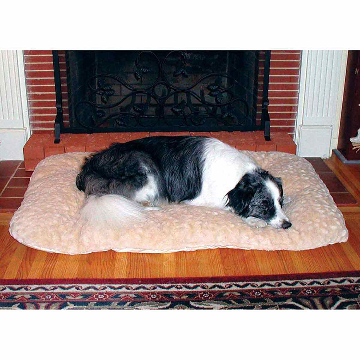 Medium Dog Sleeping on Snoozzy Comforter 23 inches by 16 inches Natural
