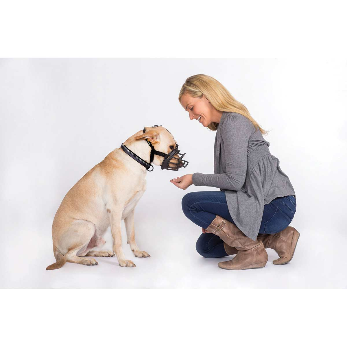 Woman feeding Baskerville Ultra Muzzle Size 5 Lab - available at Ryan's Pet Supplies