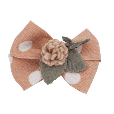 Pink Fancy Finishes Floral Design Bows with Flower