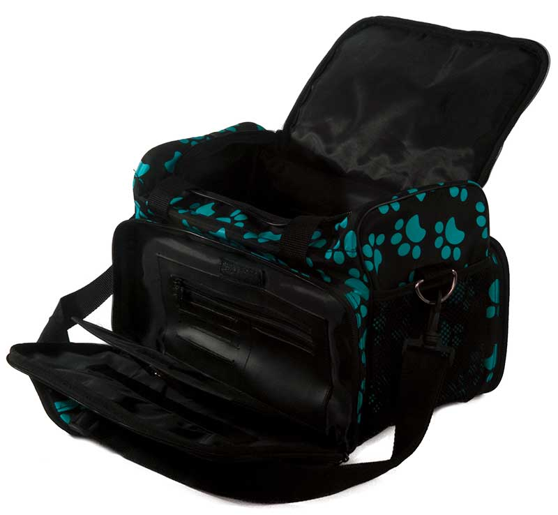 Unzipped and open Wahl Travel Paw Print Bag Turquoise to see all the Pockets and Zippers