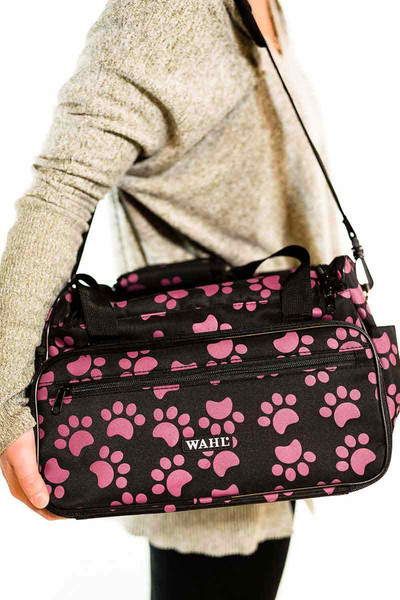 Woman carrying Wahl Travel Paw Print Bag Berry